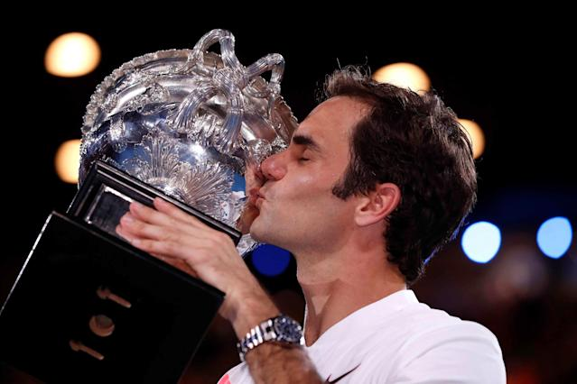 Tennis - Australian Open - Men's singles final - Rod Laver Arena, Melbourne, Australia, January 28, 2018. Switzerland's Roger Federer celebrates with the trophy after winning the final against Croatia's Marin Cilic. REUTERS/Issei Kato TPX IMAGES OF THE DAY