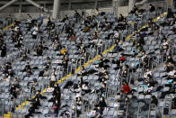 Fans wearing face masks as a precaution against the coronavirus sit while maintaining social distancing during the Game 4 of the Korean Series, the Korea Baseball Organization's championship round, between Doosan Bears and NC Dinos at Gocheok Sky Dome in Seoul, South Korea, Saturday, Nov. 21, 2020. (AP Photo/Ahn Young-joon)