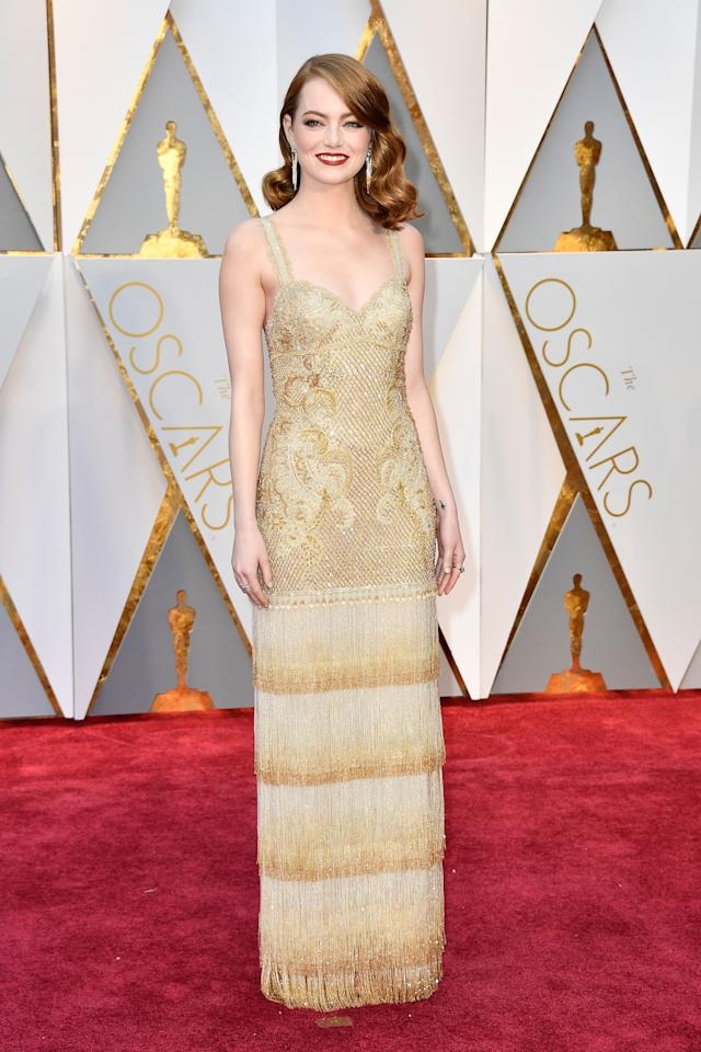<p>Emma Stone got her hands on one of the last dresses Riccardo Tisci made for Givenchy. The gold number was embellished and intricate and the gold color was fit for the best actress winner.<em>(Photo: Getty Images)</em> </p>
