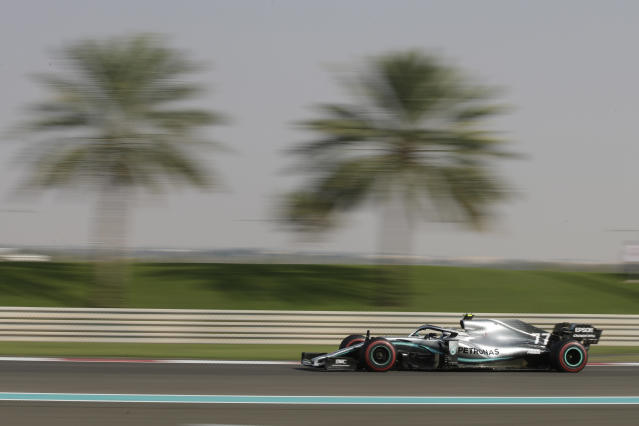 Mercedes driver Valtteri Bottas of Finland steers his car during the third free practice at the Yas Marina racetrack in Abu Dhabi, United Arab Emirates, Saturday, Nov. 30, 2019. The Emirates Formula One Grand Prix will take place on Sunday. (AP Photo/Luca Bruno)