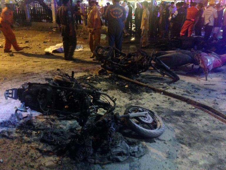 Destroyed motorbikes are seen at the scene of devastation after a bomb exploded outside a religious shrine in central Bangkok late on August 17, 2015