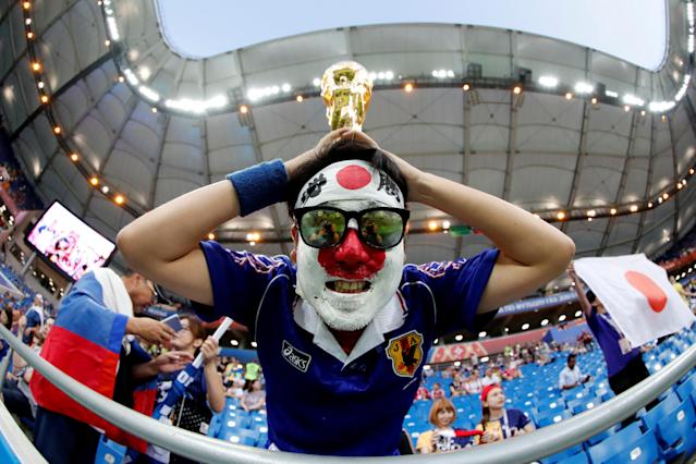 <p>Japan fan with a replica World Cup trophy inside the stadium before the match REUTERS/Jorge Silva </p>