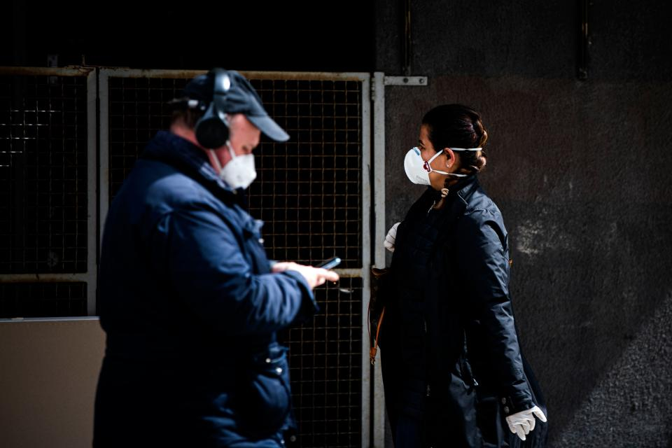 Pedestrians wearing protective face masks walk in Stockholm on May 4, 2020 during the new coronavirus Covid-19 pandemic. (Photo by Jonathan NACKSTRAND / AFP) (Photo by JONATHAN NACKSTRAND/AFP via Getty Images)