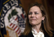 Judge Amy Coney Barrett, President Donald Trumps nominee for the U.S. Supreme Court, meets with Sen. Roger Wicker, R-Miss., not pictured, on Capitol Hill in Washington, Thursday, Oct. 1, 2020. (Olivier Douliery/Pool via AP)
