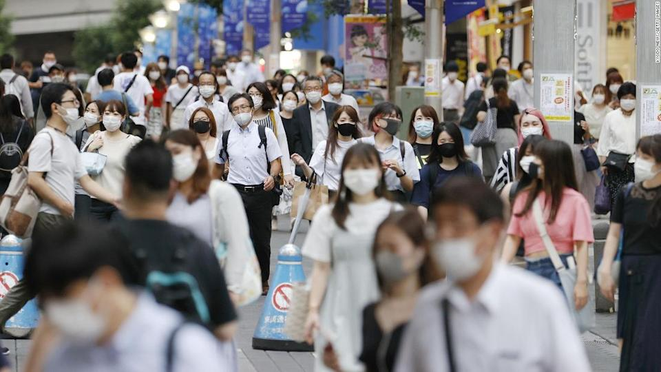 """<p>Masks were commonly used in Japan even before the pandemic. Now their use is widespread.</p><div class=""""cnn--image__credit""""><em><small>Credit: Kyodo News/Getty Images / Getty</small></em></div>"""