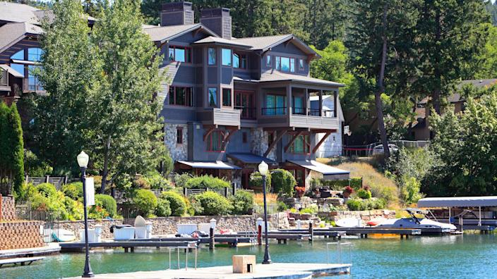 Bigfork,Montana,USA-  August 18,2019: Waterfront Group of condos with small docks,boats, lamp posts and bags.