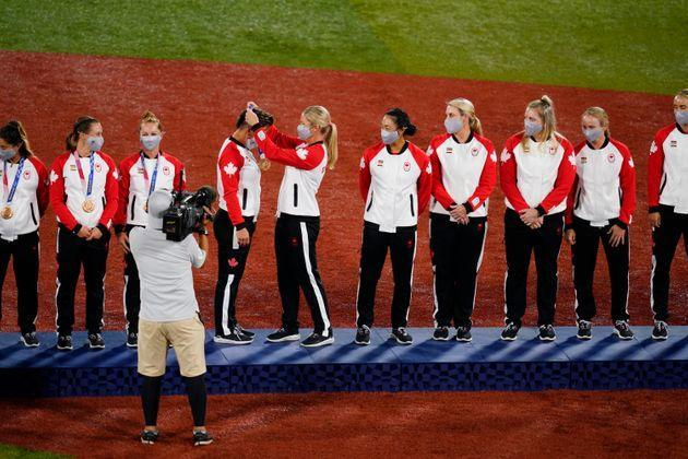 Members of Team Canada receive their bronze medals on the podium during the medal ceremony for softball on July 27 in Yokohama. (Photo: Matt Slocum via AP)