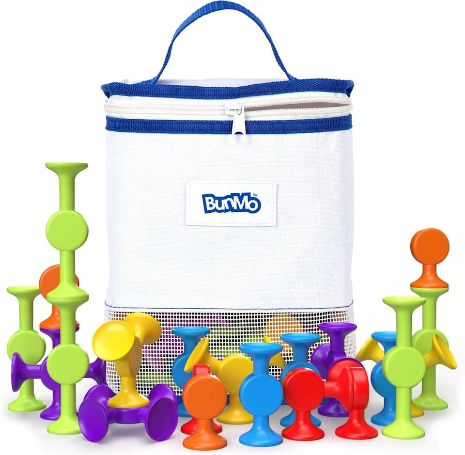 <p>Who says sensory playtime can't happen in the bath? This <span>BunMo Bath Toys with Suction Bathtub Toy Organizer</span> ($20, originally $23) comes with 24 suction construction toys that stick to each other and non-porous surfaces. Plus the set includes a variety of fun colors!</p>