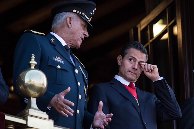 MEXICO CITY, MEXICO - SEPTEMBER 16 : President of Mexico Enrique Pena Nieto (R) and Defense Secretary Salvador Cienfuegos Zepeda watch the annual military parade at Zocalo main square, in Mexico City, Mexico on September 16, 2017. Mexico is marking the 207th anniversary of its independence. (Photo by Daniel Cardenas/Anadolu Agency/Getty Images)