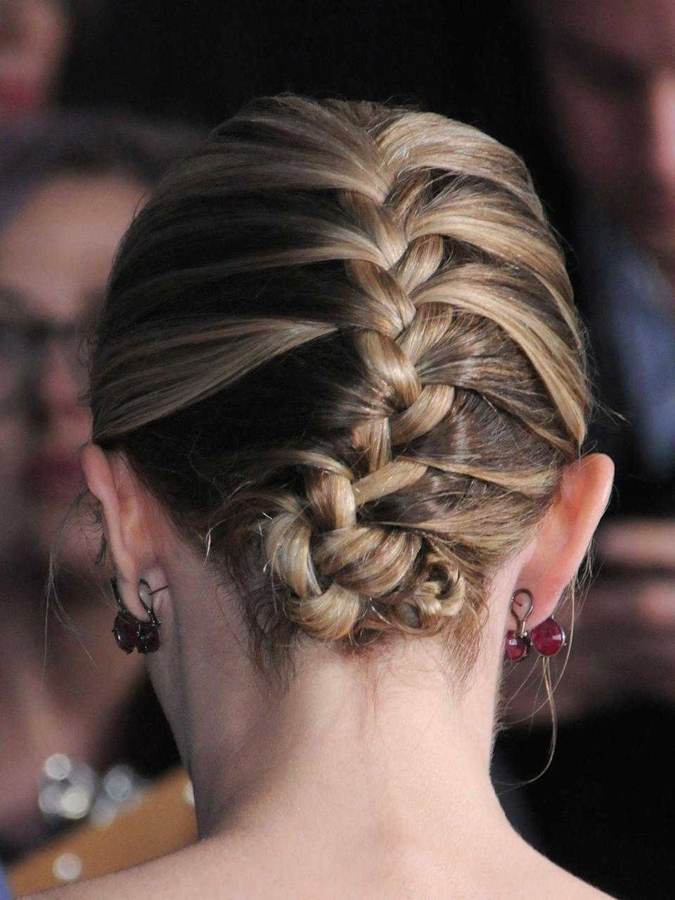 <p>Give a classic French plait a 2018 update by twisting it into a chic updo a la Emily Blunt.</p>
