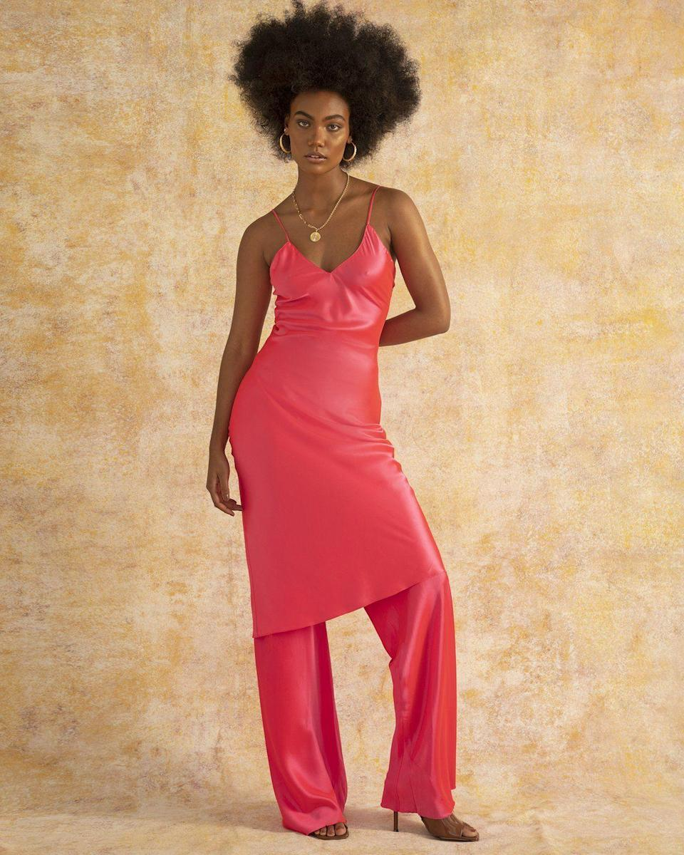 """<p><strong>Fe Noel</strong></p><p>fenoel.com</p><p><strong>$563.00</strong></p><p><a href=""""https://fenoel.com/collections/shop-all/products/flamingo-pink-silk-slip-pant?variant=39499534041187"""" rel=""""nofollow noopener"""" target=""""_blank"""" data-ylk=""""slk:Shop Now"""" class=""""link rapid-noclick-resp"""">Shop Now</a></p><p>Dress up a pair of hot pink silky pants with the matching dress over it, or make it low-key with a plain white tee. </p>"""