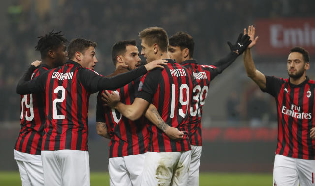 AC Milan players celebrate after scoring the opening goal during the Serie A soccer match between AC Milan and Cagliari at the San Siro stadium, in Milan, Italy, Sunday, Feb. 10, 2019. (AP Photo/Antonio Calanni)