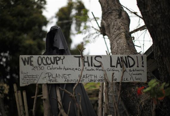 A protest sign is seen outside a trailer home in Village Trailer Park in Santa Monica, July 12, 2012.