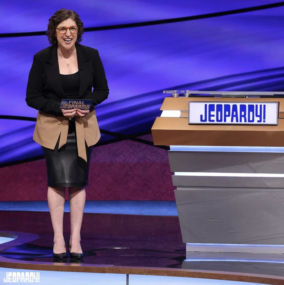 Mayim Bialik hosts Jeopardy! in neutral colors. (Instagram)