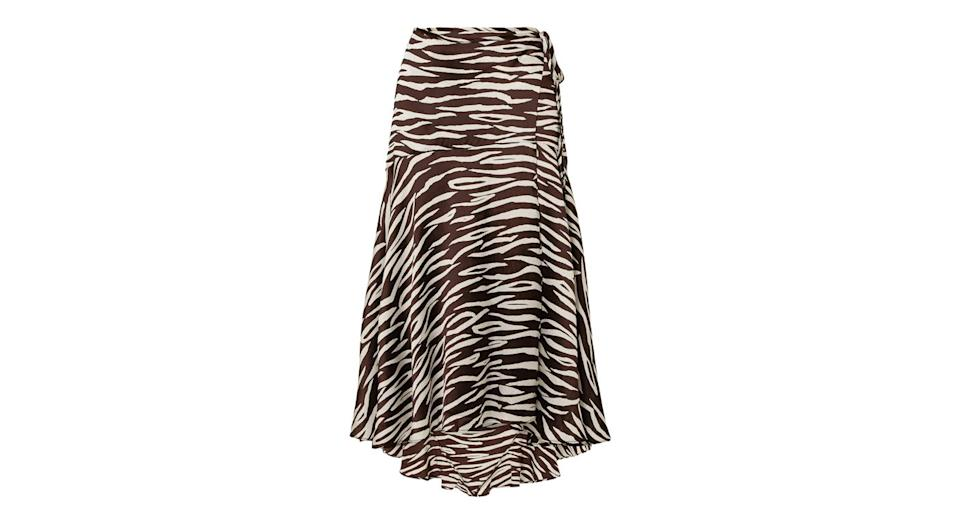 """<p>We wasn't lying about out animal print love-in: just look at this wrap skirt by Ganni. <br><a rel=""""nofollow noopener"""" href=""""https://www.net-a-porter.com/gb/en/product/1079687?cm_mmc=Google-ProductSearch-UK--c-_-NAP_EN_UK_PLA-_-NAP%C2%A0-%C2%A0UK%C2%A0-%C2%A0GS%C2%A0-+Designer+-+Class_Clothing%C2%A0-+Type_Skirts+%26+Shorts%C2%A0-%C2%A0High%C2%A0-%C2%A0BT--Skirts+-+Midi_INTL&gclid=EAIaIQobChMIzvTLnNaj3QIVbbftCh2CbwtSEAQYASABEgLP_fD_BwE&gclsrc=aw.ds"""" target=""""_blank"""" data-ylk=""""slk:Buy here."""" class=""""link rapid-noclick-resp"""">Buy here.</a> </p>"""