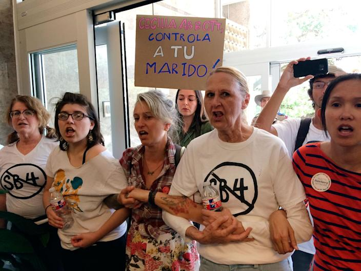 <p>A group of protesters rally during a sit-in at the Texas Department of Insurance building in Austin, Texas on Monday, May 1, 2017. The protesters, opposing proposed Texas legislation that would compel police to enforce federal immigration laws, vow to occupy the building until Republican Gov. Greg Abbott vetoes the bill. (AP Photo/Meredith Hoffman) </p>