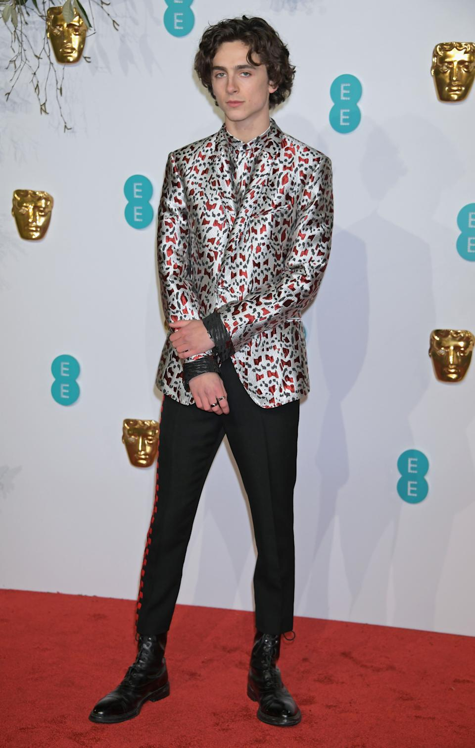 Wearing a Haider Ackermann printed suit jacket and matching shirt. <em>[Photo: Getty]</em>