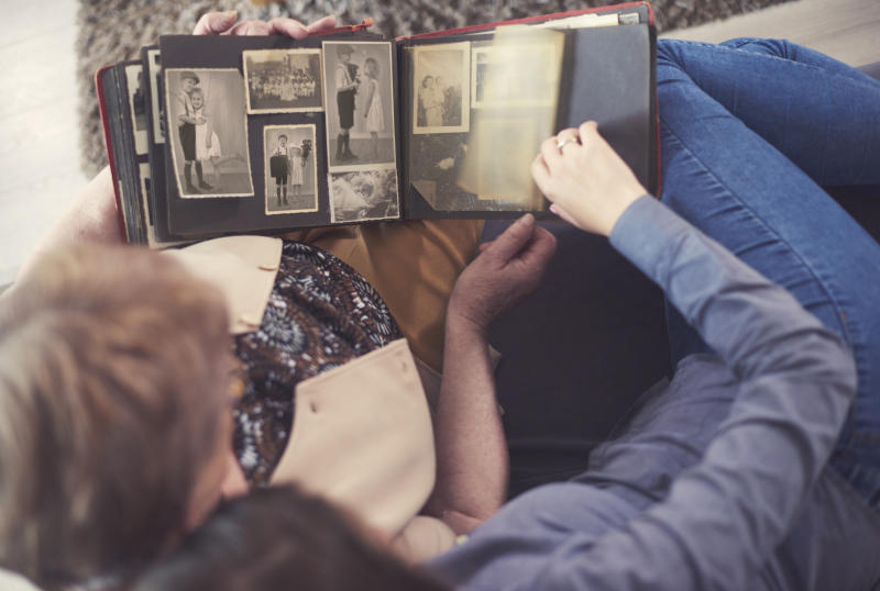 Don't let your old photo albums collect dust—convert those precious memories to digital. (Photo: Getty Images)