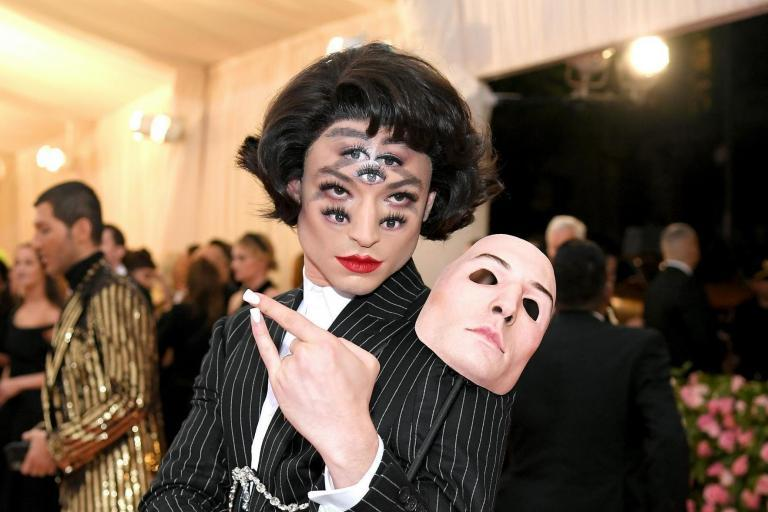 Ezra Miller's red carpet style: From Met Gala eyes to Moncler puffer jackets, the Fantastic Beasts star's trippy looks