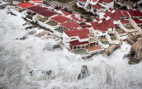 Homes on Saint-Martin are threatened by storm surges in the wake of Hurricane Irma - Credit: REUTERS