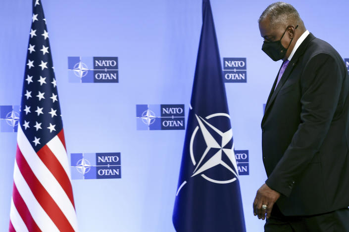 United State Secretary of Defense Lloyd Austin steps onto the podium during arrival prior to a meeting at NATO headquarters in Brussels, Wednesday, April 14, 2021. (Kenzo Tribouillard, Pool via AP)