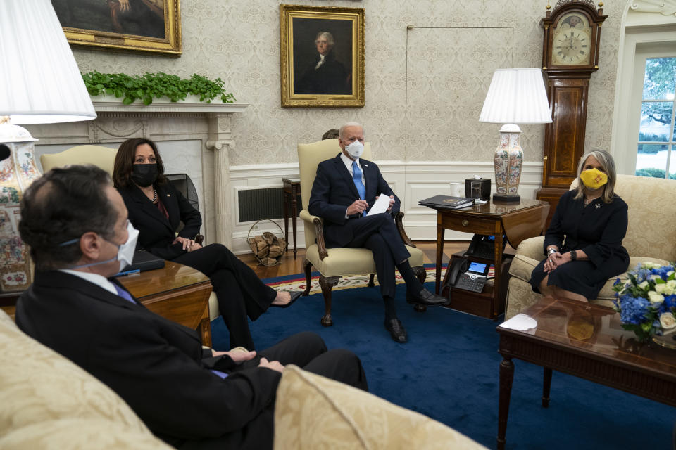 President Joe Biden speaks during a meeting with a bipartisan group of mayors and governors to discuss a coronavirus relief package, in the Oval Office of the White House, Friday, Feb. 12, 2021, in Washington. From left, Gov. Andrew Cuomo, D-N.Y., Vice President Kamala Harris, Biden, and Gov. Michelle Lujan Grisham, D-N.M. (AP Photo/Evan Vucci)