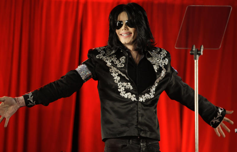 """FILE - In this March 5, 2009 file photo, US singer Michael Jackson is shown at a press conference in London, announcing plans to appear at the London O2 Arena in July. Jackson's earning potential may become an issue when a Los Angeles jury begins deliberating a negligent hiring lawsuit filed by the singer's mother, Katherine Jackson, against concert giant AEG Live LLC over her son's 2009 death. Witnesses have testified throughout the 21-week trial that the pop superstar was planning a new career in movies after completing his """"This Is It"""" tour that was scheduled to begin in July 2009. (AP Photo/Joel Ryan, file)"""