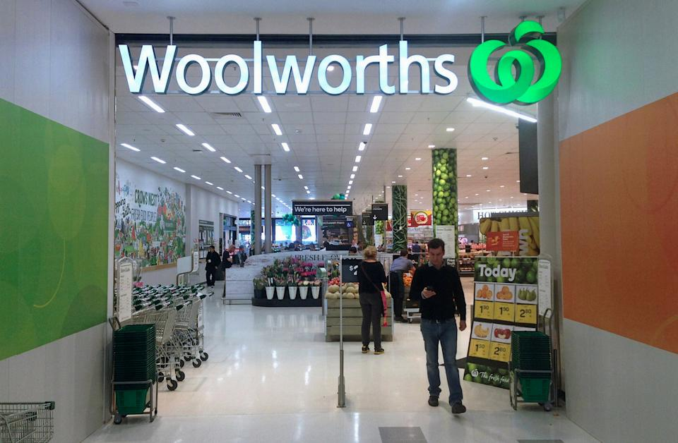 A customer walks out of a Woolworths store. Source: Reuters