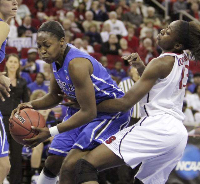 Duke's Chelsea Gray, left, is fouled by Stanford's Chiney Ogwumike during the first half of an NCAA women's tournament regional final college basketball game, Monday, March 26, 2012, in Fresno, Calif.(AP Photo/Rich Pedroncelli)