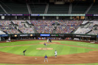 "The lower level seats at Globe Life Field are filled with cardboard cutouts depicting fans, dubbed ""DoppleRangers,"" as Colorado Rockies pitcher German Marquez delivers to Texas Rangers' Joey Gallo during the sixth inning of an opening day baseball game Friday, July 24, 2020, in Arlington, Texas. (AP Photo/Jeffrey McWhorter)"