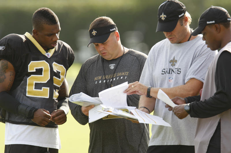 FILE - This Aug. 5, 2009 file photo shows, former New Orleans Saints assistant football coach Mike Cerullo, second from left, meeting with, from left, Saints cornerback Tracy Porter (22), assistant special teams coach Mike Mallory, and assistant secondary coach Tony Oden, in Metairie, La. Former NFL Commissioner Paul Tagliabue and lawyers for the league and the players' union have arrived in Washington, Thursday for a hearing in the Saints bounties case. Tagliabue is overseeing the latest round of player appeals in Washington. Cerullo is a key witness in the NFl's investigation. (AP Photo/Bill Haber, File)