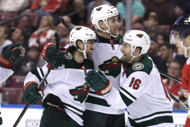 Minnesota Wild center Mats Zuccarello (36) celebrates with left wing Jason Zucker (16) after scoring a goal during the second period of an NHL hockey game against the Florida Panthers, Tuesday, Dec. 3, 2019, in Sunrise, Fla. (AP Photo/Lynne Sladky)