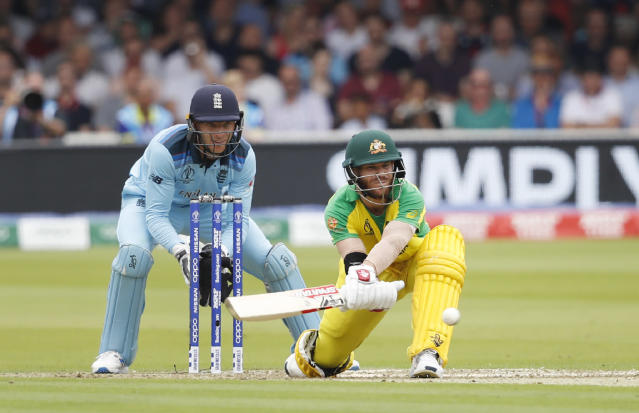 Australia's David Warner plays a shot off the bowling of England's Adil Rashid during their Cricket World Cup match between England and Australia at Lord's cricket ground in London, Tuesday, June 25, 2019. (AP Photo/Alastair Grant)