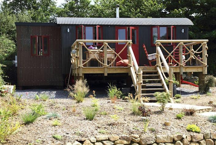 """<p>Located near Watergate Bay in Cornwall, England of all places, the Sundance, a Wild West-themed wagon-style dwelling, is available to rent through <a href=""""http://www.uniquehomestays.com/"""" rel=""""nofollow noopener"""" target=""""_blank"""" data-ylk=""""slk:Unique Homestays"""" class=""""link rapid-noclick-resp"""">Unique Homestays</a>. Decorated with a """"saloon chic"""" aesthetic (think wagon wheel art and sheepskin throws), the quaint interior features a wood-clad master bedroom, a bathroom with a walk-in rain shower, and a full kitchen. After a day riding horses on the nearby beach, relax with a glass of wine while sitting in a rocking chair on the lantern-lit front porch. Rental rates are about $800 for a three-night stay. </p><p><a class=""""link rapid-noclick-resp"""" href=""""http://www.uniquehomestays.com/unique/details.asp?id=3595#photo-1"""" rel=""""nofollow noopener"""" target=""""_blank"""" data-ylk=""""slk:SEE INSIDE"""">SEE INSIDE</a></p>"""