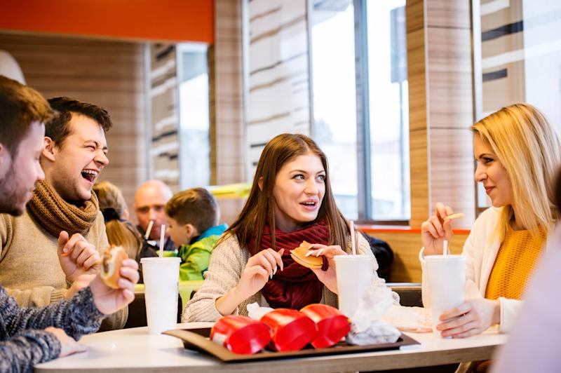 Four friends eating fast food.