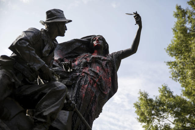 <p>A statue depicting a Confederate soldier in Piedmont Park in Atlanta is vandalized with spray paint Monday, Aug. 14, 2017, from protesters who marched through the city last night to protest the weekend violence in Charlottesville, Va. (Photo: David Goldman/AP) </p>