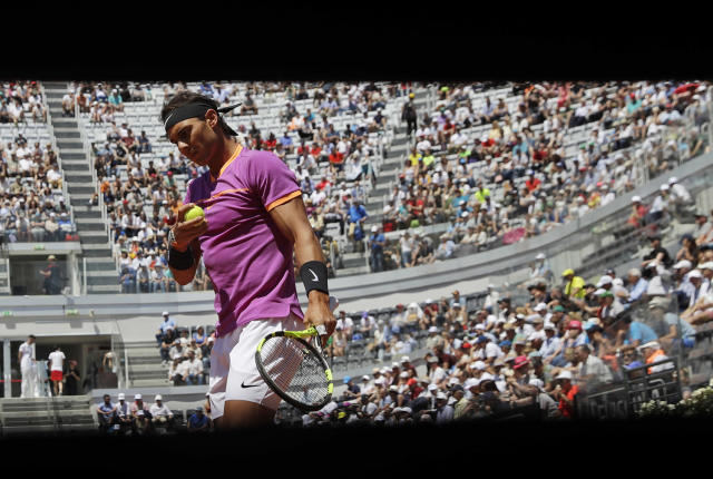 <p>Spain's Rafael Nadal prepares to serve the ball during his match against his fellow-countryman Nicolas Almagro, at the Italian Open tennis tournament, in Rome, May 17, 2017. (Photo: Alessandra Tarantino/AP) </p>