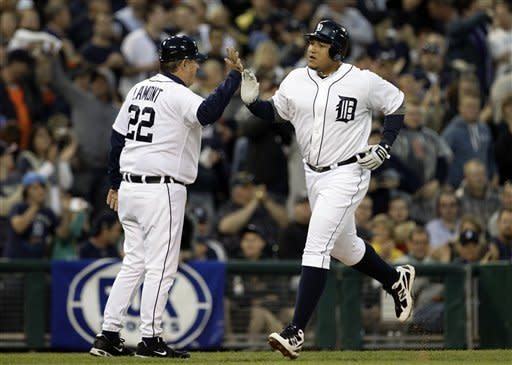 Detroit Tigers' Miguel Cabrera is congratulated by Detroit Tigers third base coach Gene Lamont after hitting a solo home run against the New York Yankees in the fourth inning of a baseball game in Detroit, Saturday, June 2, 2012. (AP Photo/Paul Sancya)