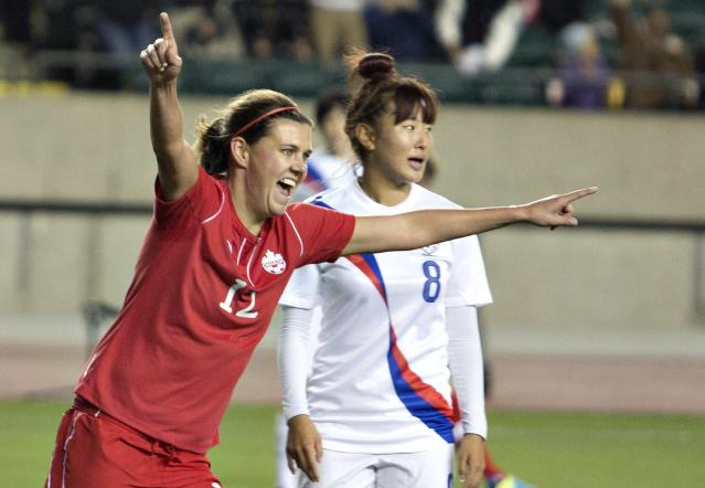 South Korea's So Hyun Cho (8) looks away as Canada's Christine Sinclair (12) celebrates a goal during the first half of an international friendly soccer match, Wednesday, Oct. 30, 2013, in Edmonton, Alberta. (AP Photo/The Canadian Press, Jason Franson)