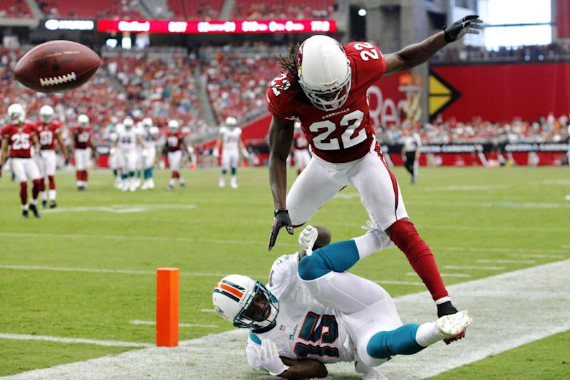Arizona Cardinals cornerback William Gay (22) breaks up a pass intended for Miami Dolphins wide receiver Davone Bess (15) during the second half of an NFL football game, Sunday, Sept. 30, 2012, in Glendale, Ariz. (AP Photo/Paul Connors)