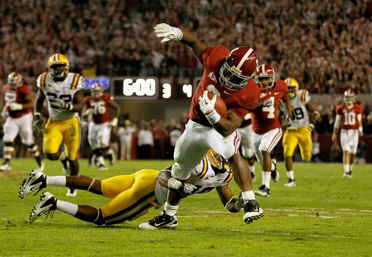 TUSCALOOSA, AL - NOVEMBER 05:  Trent Richardson #3 of the Alabama Crimson Tide runs with the ball during the first half of the game against the LSU Tigers at Bryant-Denny Stadium on November 5, 2011 in Tuscaloosa, Alabama.  (Photo by Streeter Lecka/Getty Images)