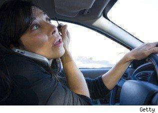 woman drives with cellphone and makeup