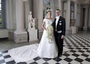 "<p>For her wedding to her personal trainer and gym owner Daniel Westling, Crown Princess Victoria of Sweden wore an off-the-shoulder gown designed by Pär Engsheden. Victoria is the heir to Sweden's throne and—fun fact—is also <a href=""https://www.huffingtonpost.com/yvonne-yorke/a-royal-fairytale-with-a_b_612620.html"" rel=""nofollow noopener"" target=""_blank"" data-ylk=""slk:196th in line"" class=""link rapid-noclick-resp"">196th in line</a> to the British throne through her father, a third cousin of the Queen. </p>"
