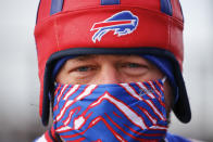 A Buffalo Bills fan arrives at Bills Stadium for an NFL wild-card playoff football game against the Indianapolis Colts Saturday, Jan. 9, 2021, in Orchard Park. (AP Photo/Jeffrey T. Barnes)