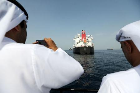 FILE PHOTO: Port officials take a photo of the damaged tanker Andrea Victory at the Port of Fujairah