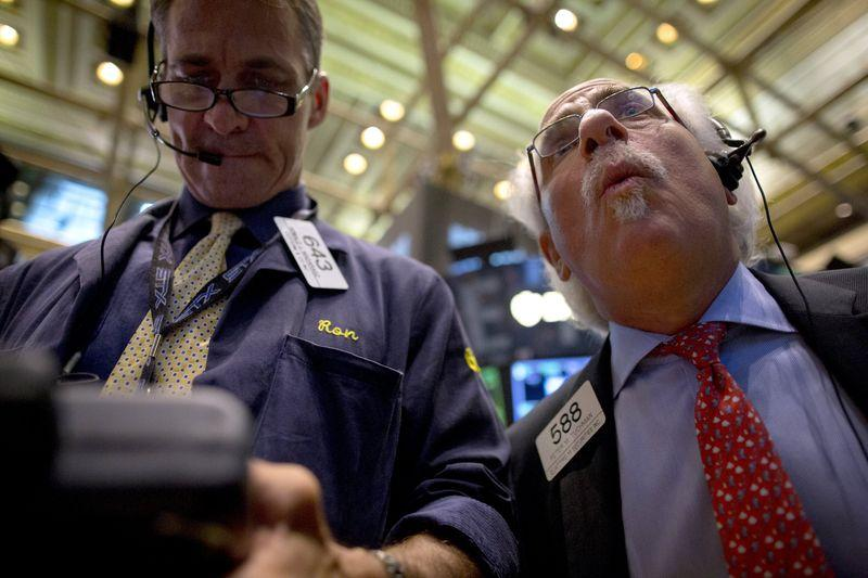 Traders work on floor of the New York Stock Exchange