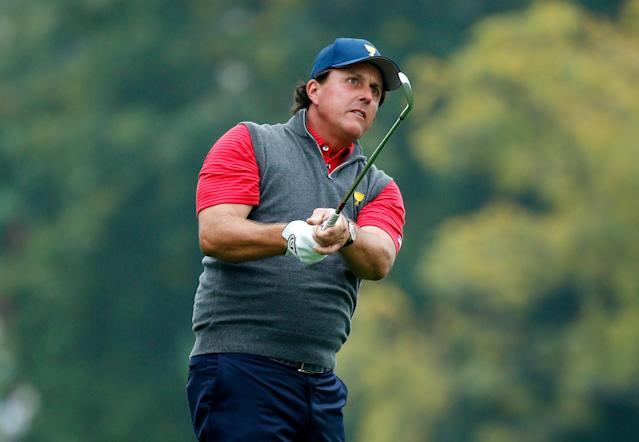 DUBLIN, OH - OCTOBER 02: Phil Mickelson of the U.S. Team hits a shot during a practice round prior to the start of The Presidents Cup at the Muirfield Village Golf Club on October 2, 2013 in Dublin, Ohio. (Photo by Andy Lyons/Getty Images)