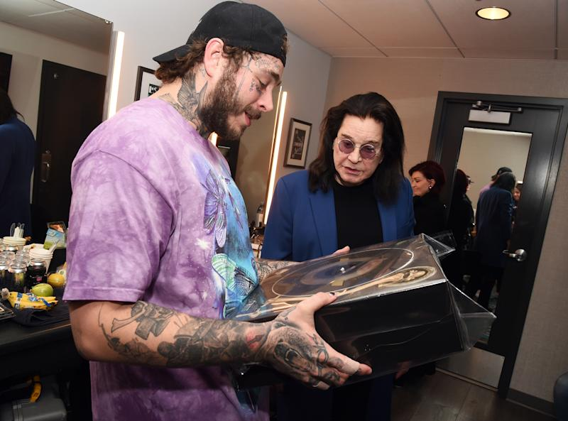 LOS ANGELES, CALIFORNIA - NOVEMBER 22: (L-R) Post Malone and Ozzy Osbourne are seen backstage during the 2019 American Music Awards Rehearsals at Microsoft Theater on November 22, 2019 in Los Angeles, California. (Photo by Kevin Winter/AMA2019/Getty Images for dcp)
