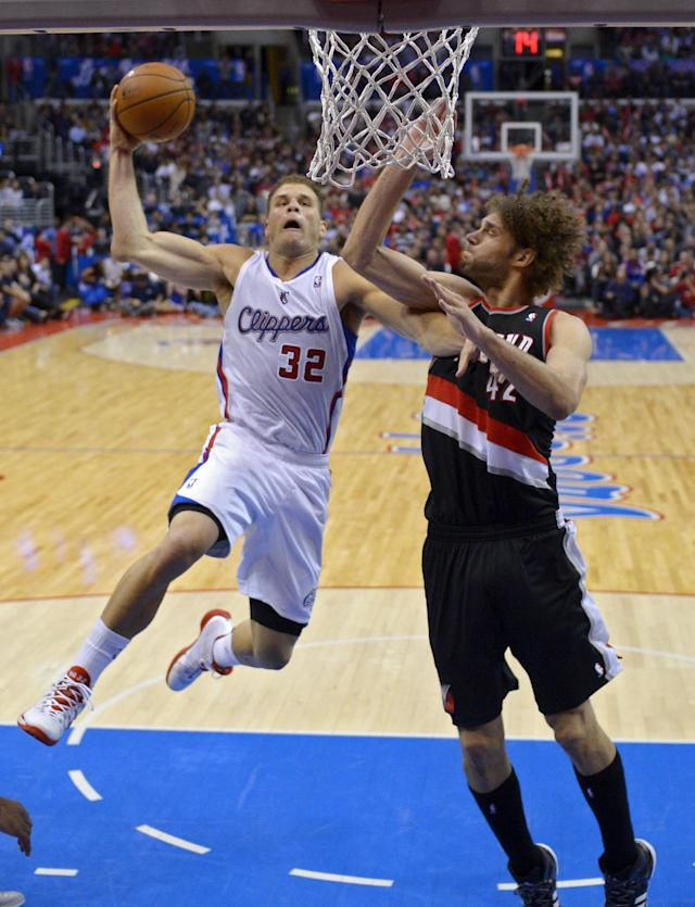 Los Angeles Clippers forward Blake Griffin, left, puts up a shot as Portland Trail Blazers center Robin Lopez defends during the second half of an NBA basketball game, Wednesday, Feb. 12, 2014, in Los Angeles. (AP Photo/Mark J. Terrill)