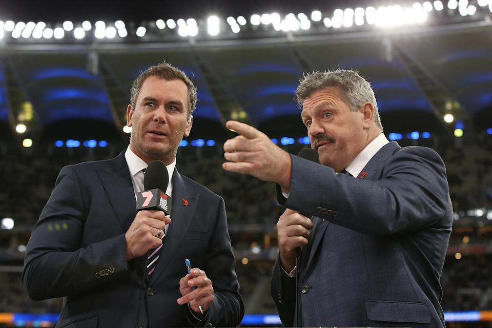 Commentators Wayne Carey and Brian Taylor talk to camera before the round 14 AFL match between the West Coast Eagles and the Essendon Bombers at Optus Stadium on June 20, 2019 in Perth, Australia
